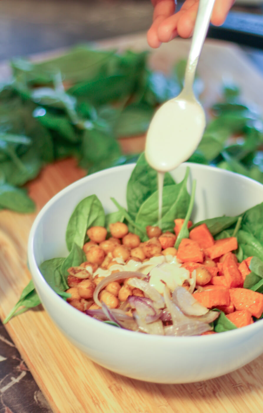 Spinach salad with roasted chickpea, sweet potato and onions