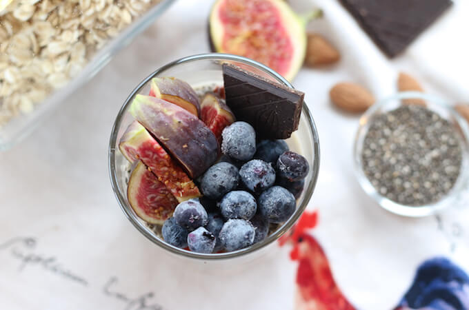 basic overnight oats in a jar with fresh figs blueberries and chocolate
