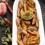 curry spiced oven roasted potatoes, homemade potato wedges